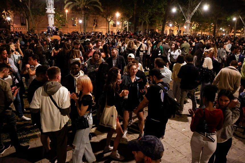 Hundreds of people celebrate the end of the state of emergency in Barcelona, on May 8, 2021.