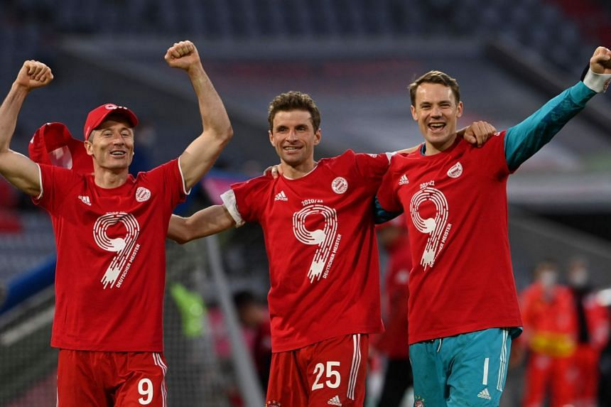 Bayern Munich's (from left) Robert Lewandowski, Thomas Mueller and Manuel Neuer celebrate after the match against Borussia Moenchengladbach.