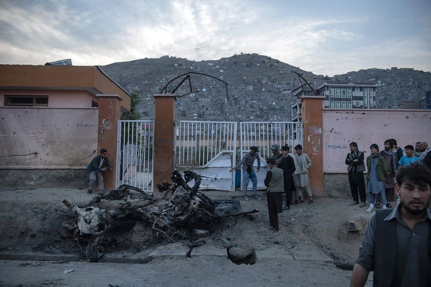 A car that exploded at the gate of Sayed Ul-Shuhada high school in Kabul on May 8, 2021.