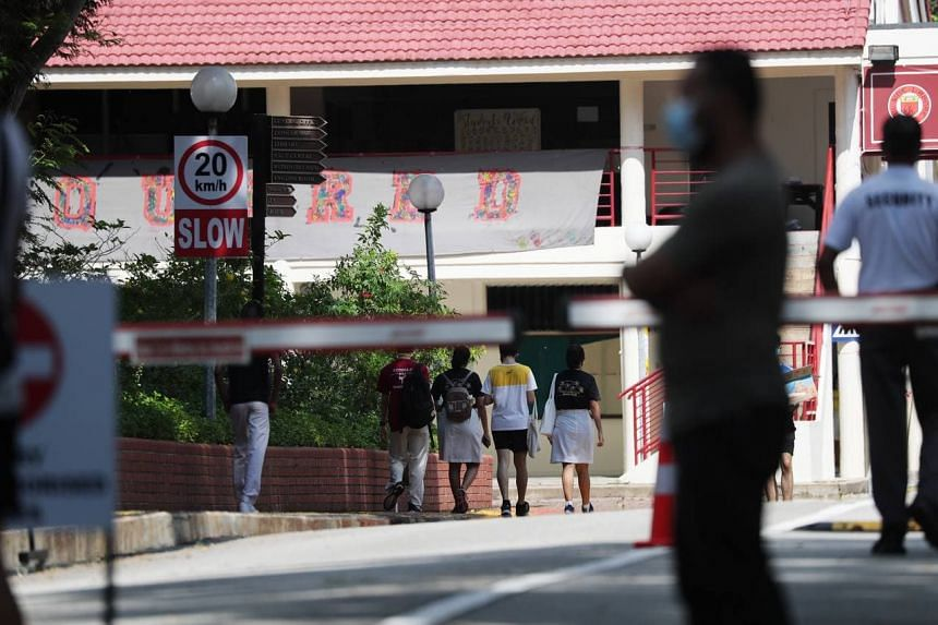 Students entering the Victoria Junior College campus, where a Covid-19 testing exercise is under way.