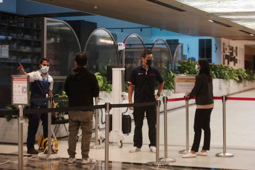 Barricades being set up to bar the public from entering the B2 level at Changi Airport Terminal 3, on May 10, 2021.