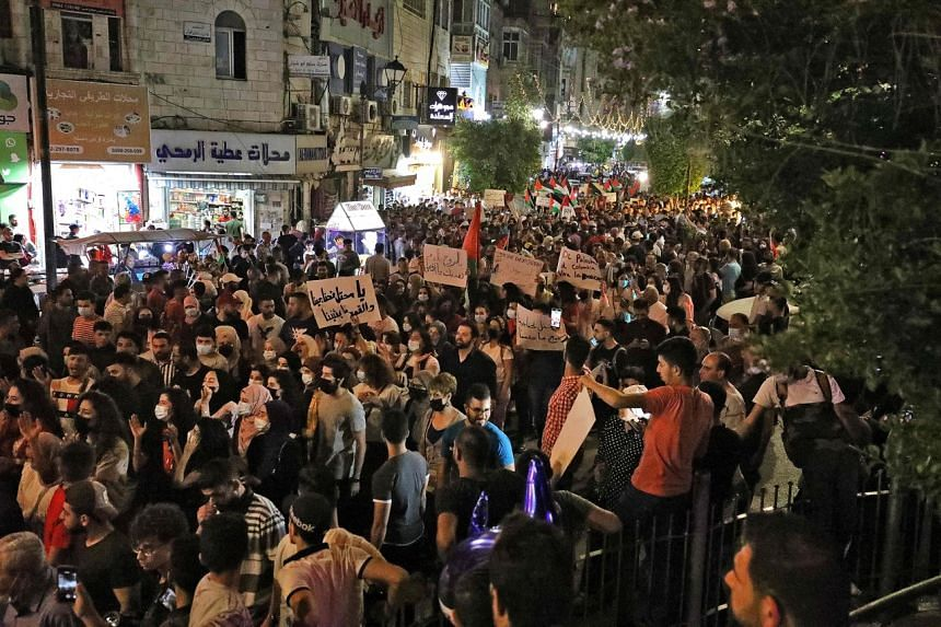 Palestinians protest in the occupied West Bank city of Ramallah on May 9, 2021.