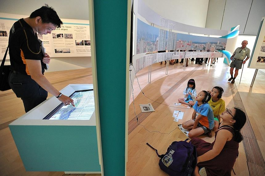 Visitors viewing interactive displays at the ST170 exhibition held at the ArtScience Museum in 2015. For the newspaper, which celebrated its 175th anniversary last year and has seen more than its fair share of convulsions, this restructuring is as go
