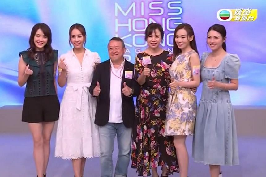 Actor-host Eric Tsang (centre) says this year's Miss Hong Kong Pageant may go to Singapore.