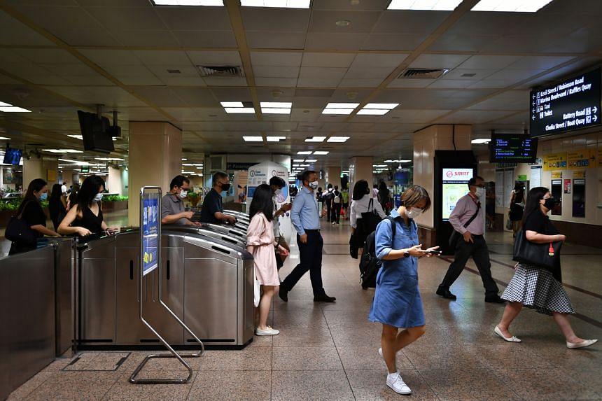 Office workers arriving at Raffles Place MRT station on May 11, 2021.
