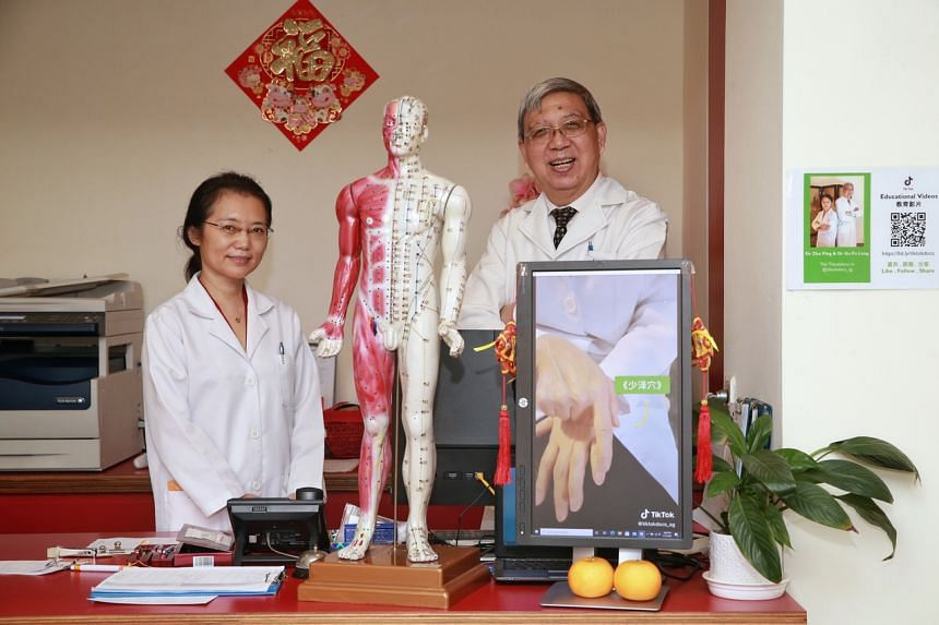 Dr Zhu Ping (left), and medical director Dr Gu Falong, who use TikTok to give tips about how to relieve common problems and pains.