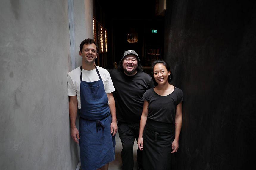 Chefs Jakob Zeller (far left) and Ethel Hoon (far right), and Laut co-owner Frank Shen (centre).