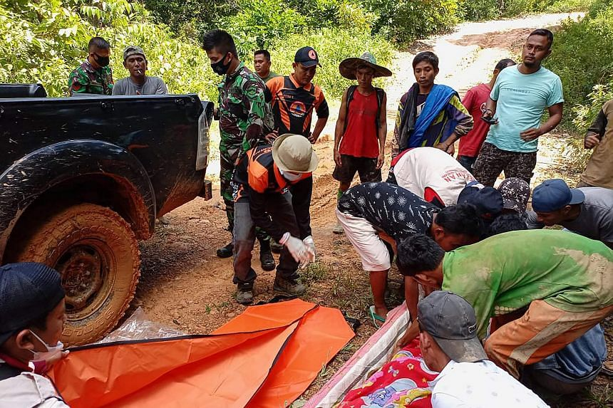 Rescuers retrieving bodies after a landslide at a gold mine in South Solok, West Sumatra province, on May 11, 2021.