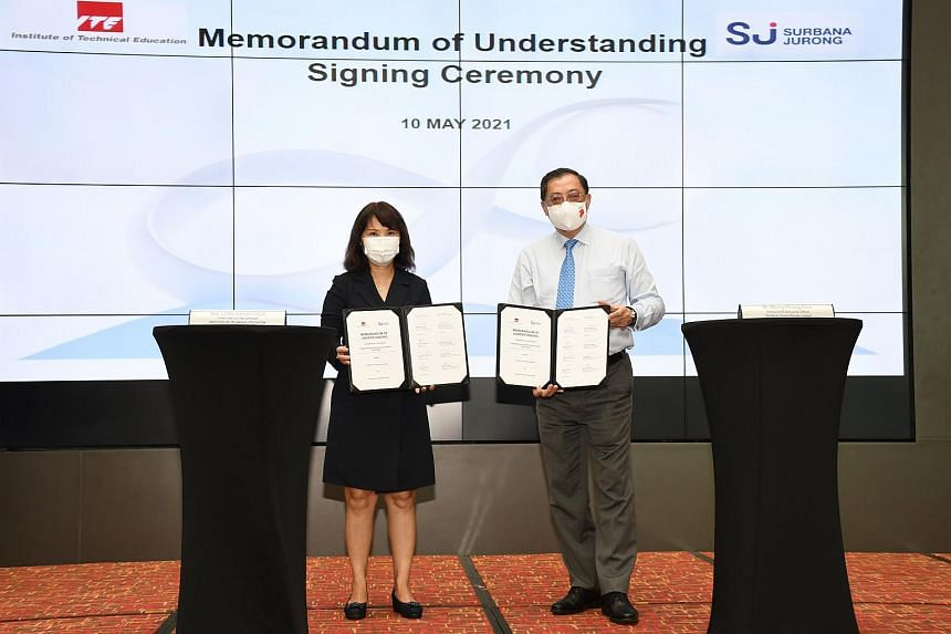 Institute of Technical Education CEO Low Khah Gek (left) and Surbana Jurong group CEO Wong Heang Fine at a signing ceremony on May 10, 2021.