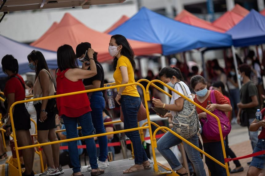 Foreign domestic workers queue for Covid-19 tests in the Central district of Hong Kong on May 2, 2021.