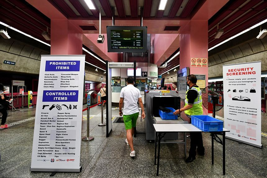 Security screening being conducted at Redhill MRT station on May 5, 2021.