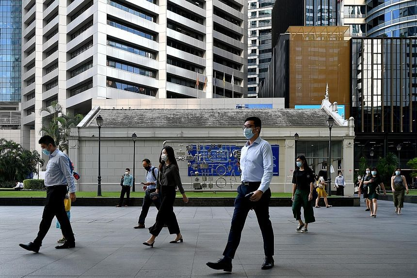 Raffles Place was quieter than usual for a working day at about 8.40am yesterday, and so were other office hot spots that The Straits Times visited on the second weekday after Singapore tightened its Covid-19 measures. With companies defaulting to wo