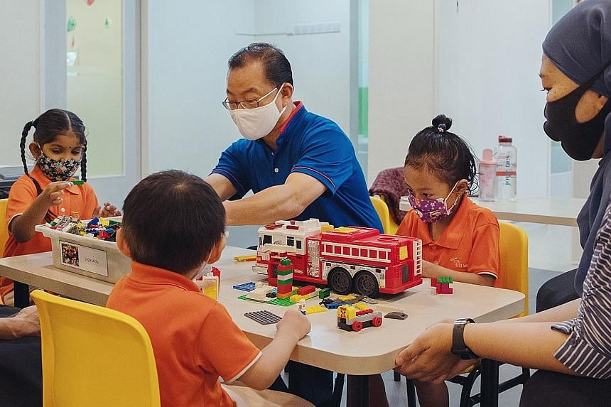 Mr Seah Kian Peng, Group CEO of NTUC Enterprise, with children who attend My First Skool. Needy families with a child enrolled in any of the My First Skool pre-school centres stand to benefit from the $350,000 Food and Nutrition Programme.