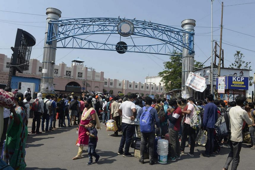 People queueing outside a railway station to return home during the first day of a government-imposed lockdown in Secunderabad, India, on May 12, 2021.