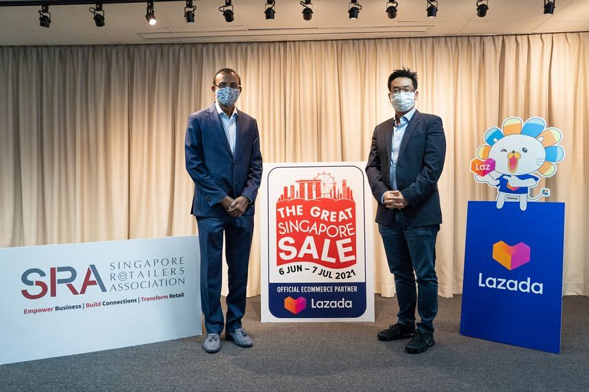 SRA president R. Dhinakaran (left) with Lazada Singapore CEO James Chang at the announcement of the partnership, on May 12, 2021.