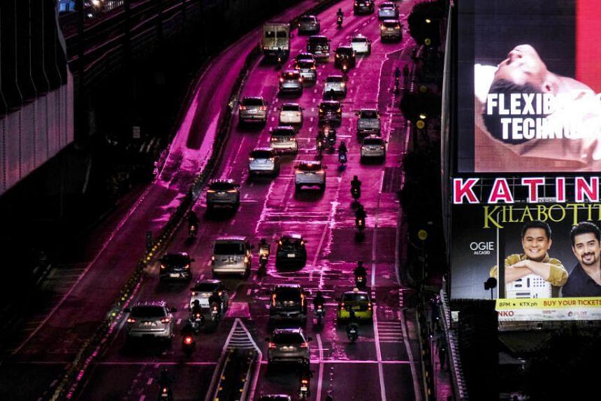 Vehicles travel along the Epifanio de los Santos Avenue (EDSA) highway in Metro Manila, the Philippines, on May 11, 2021.