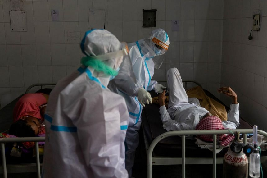 Medics tend to a man with breathing problems inside a Covid-19 ward at a hospital in Bijnor district, Uttar Pradesh, on May 11, 2021.