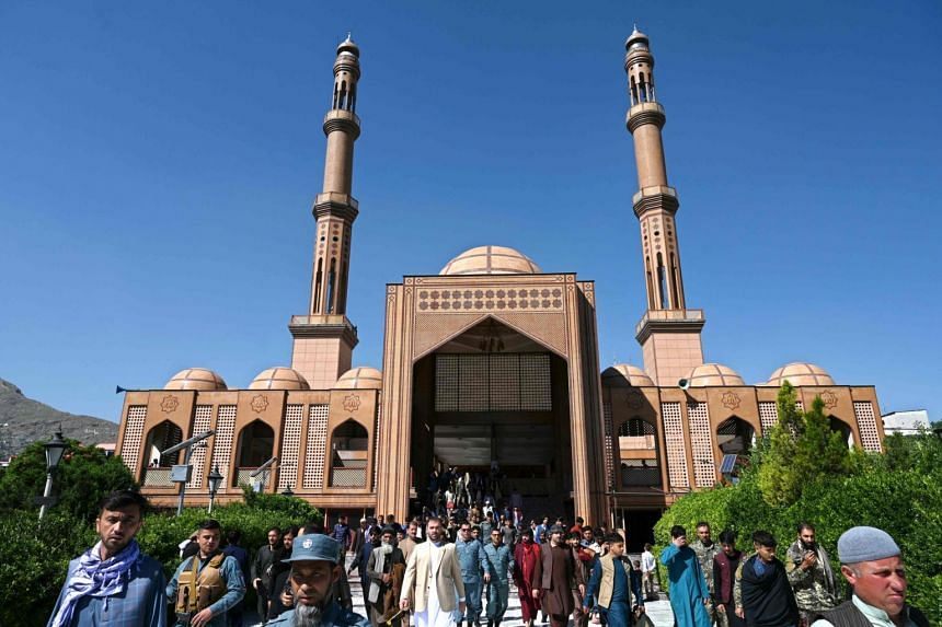 Muslim devotees leaving the Abdul Rahman Mosque after offering prayers at the Eid al-Fitr festival in Kabul, on Thursday.
