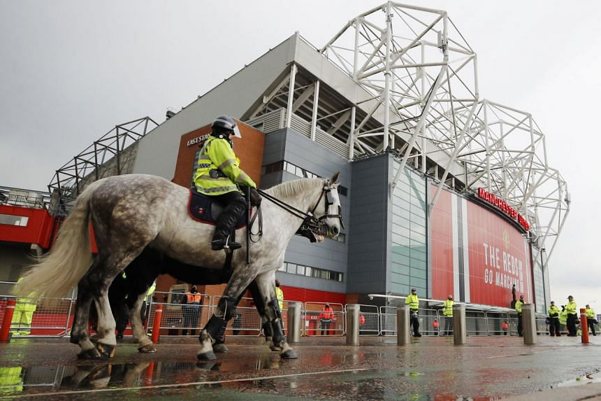 Police officers patrolling outside Old Trafford on May 13, before Manchester United's rearranged fixture against Liverpool.