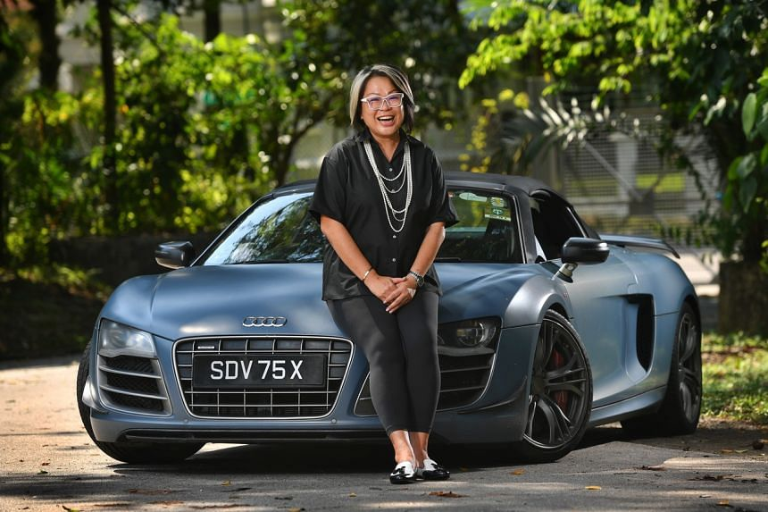 Ms Claudine Ho and her Audi R8 GT Spyder.