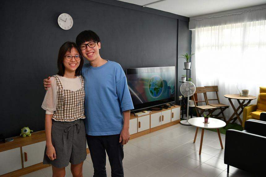 Ms Joslyn Chua and her husband Jowee Ng in their two-room flat in Canberra which they got under the Parenthood Provisional Housing Scheme.