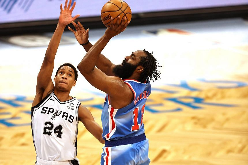 James Harden takes a shot as Devin Vassell (left) defends at Barclays Center, in Brooklyn, New York, on May 12, 2021.