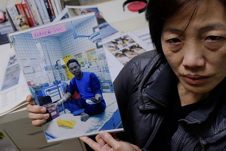 Ms Allison Lee from the Yilan Migrant Fishermen Union with a photo of a missing Indonesian fisherman last December. Taiwan operates the world's second-largest longline fishing fleet, and those who work on its vessels - mostly poor migrants from South