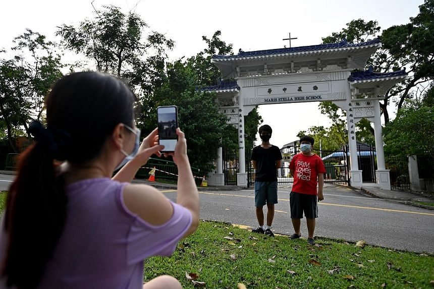 Maris Stella alumni Richard Chen was among several people who visited the school to take photos of the gate yesterday. Madam Joey Chong, a healthcare worker in her 40s, taking photographs of her son, Sky Seah (in red T-shirt), and his classmate Rapha