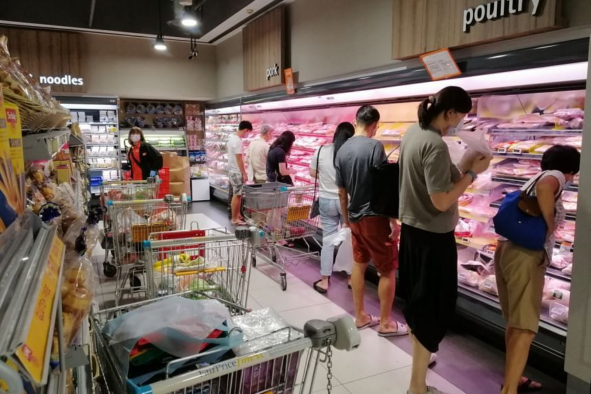 Shoppers buying meat and poultry at the FairPrice in Bukit Timah Plaza, on May 14, 2021.