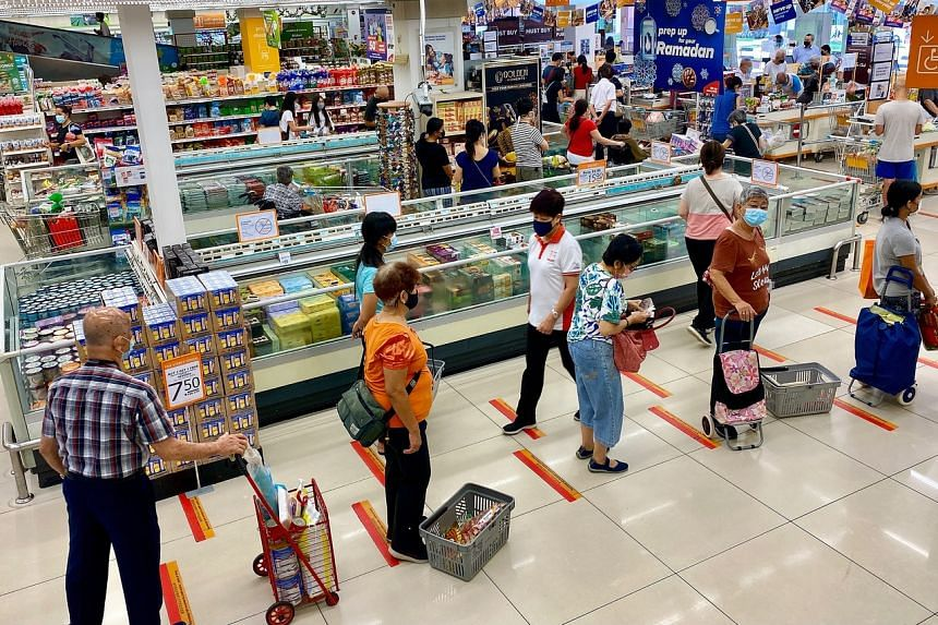 Queues forming up at the checkout counters of the FairPrice Finest in Marine Parade on May 14, 2021.