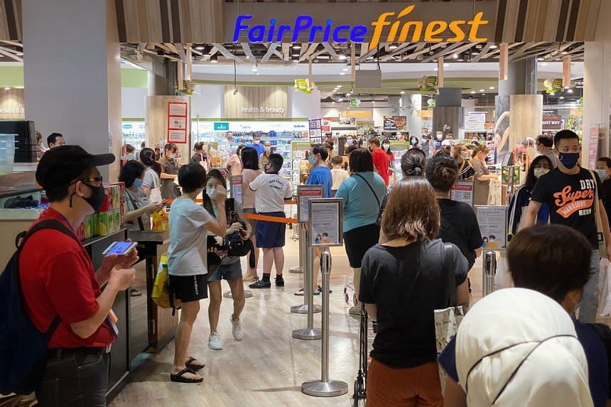 People queueing up to enter the FairPrice at Waterway Point in Punggol on May 14, 2021.