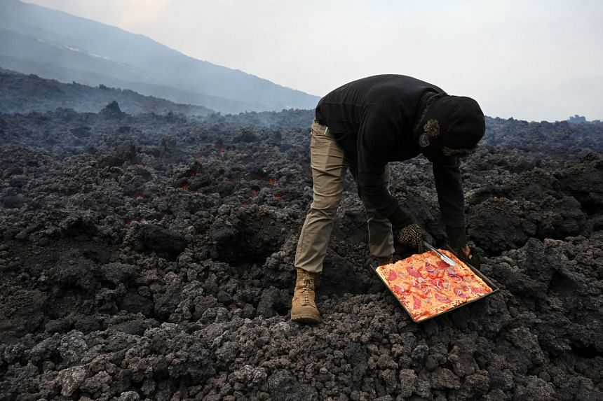 For Mr David Garcia, the streams of molten lava oozing down Guatemala's Pacaya volcano have become his kitchen.