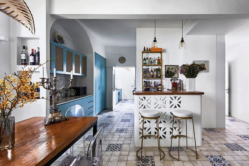 Stepping into the 3,000 sq ft three-storey house transports one into a traditional kitchen of an Italian grandmother, with faded tiles underfoot and a rustic wooden dining table.