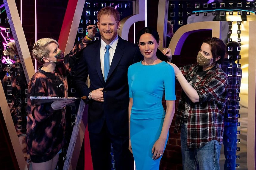 Artists prepare the wax figures of Britain's Prince Harry and Meghan, Duchess of Sussex, in their new position in Madame Tussauds in London.
