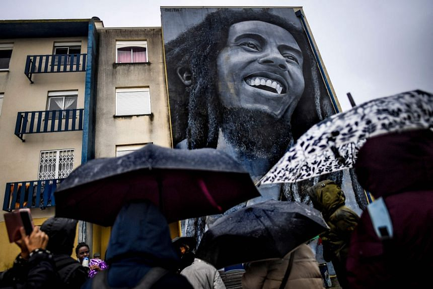 A mural by Portuguese artist Odeith of Jamaican singer Bob Marley (above, in a November 2019 photograph) in Sacavem on the outskirts of Lisbon.