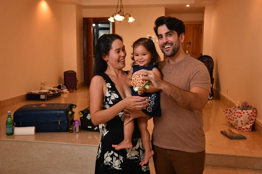 Mr Sayjel Patel with his wife Joy and their 17-month-old daughter Eleanor in their rented three-bedroom condo unit in River Valley.