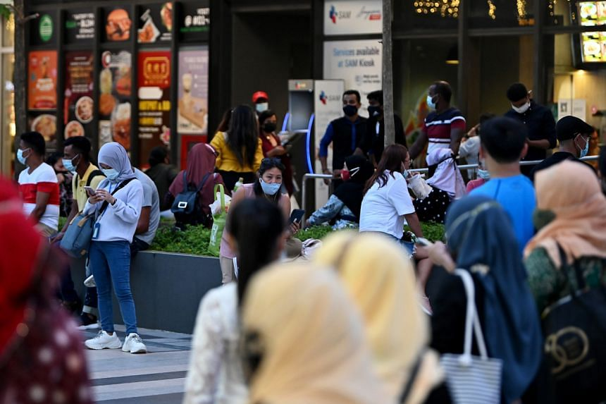 People loitering outside Paya Lebar Square on May 13, 2021.