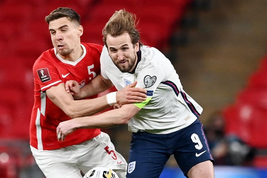 Harry Kane in action with Jan Bednarek at Wembley Stadium in London, on March 31, 2021.