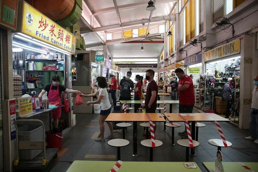 People queueing to order food for takeaway at Clementi Market and Food Centre on May 16, 2021.
