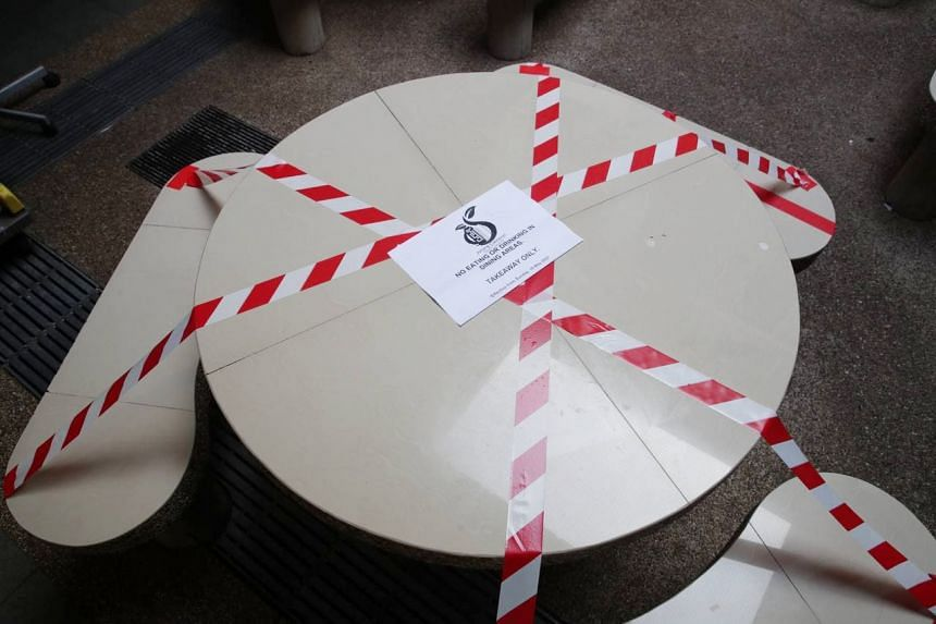 Taped up tables and chairs at Clementi Market and Food Centre on May 16, 2021.