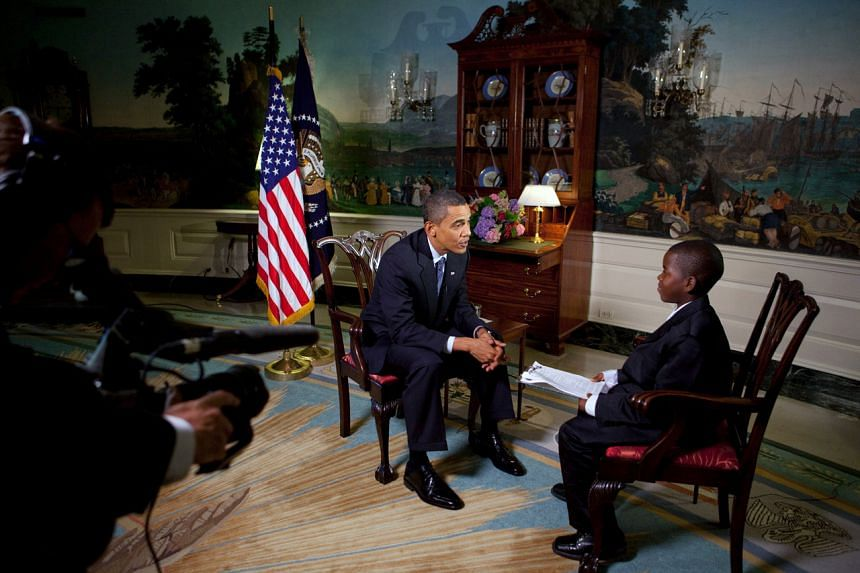 At age 11, Damon Weaver (right) interviewed President Barack Obama in the Diplomatic Room of the White House.