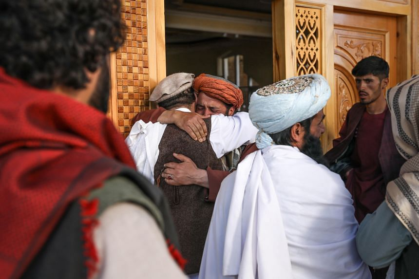 Worshippers react at the scene of an attack that targeted a mosque on the outskirts of Kabul, Afghanistan, on May 14, 2021.