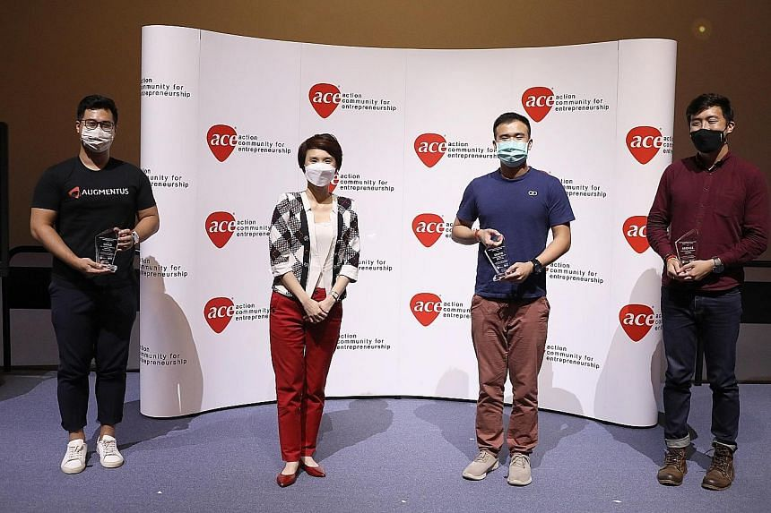 Minister of State for Trade and Industry and Culture, Community and Youth Low Yen Ling with the National Youth Entrepreneurship Awards' university and open category winners (from far left) Daryl Lim, Johann Wah and Sean Neo at the Singapore Discovery