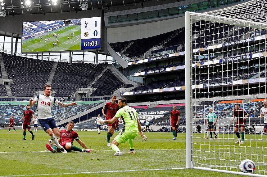 Spurs' Danish midfielder Pierre-Emile Hojbjerg slotting home their second goal in the 2-0 Premier League win over Wolves. But it came too late to revive any realistic chances of Champions League football.