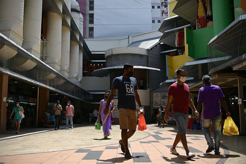 Shoppers at Tekka Market yesterday. When The Straits Times visited Little India around noon yesterday, the streets were emptier than usual, though most shops remained open for business.