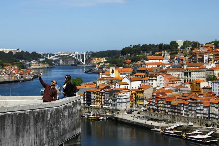 People at a viewpoint in Porto, Portugal, on May 17, 2021.