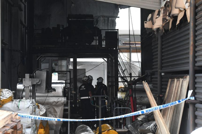 A fire investigation team at the site of an accident in Tuas that killed three workers, on Feb 25, 2021.