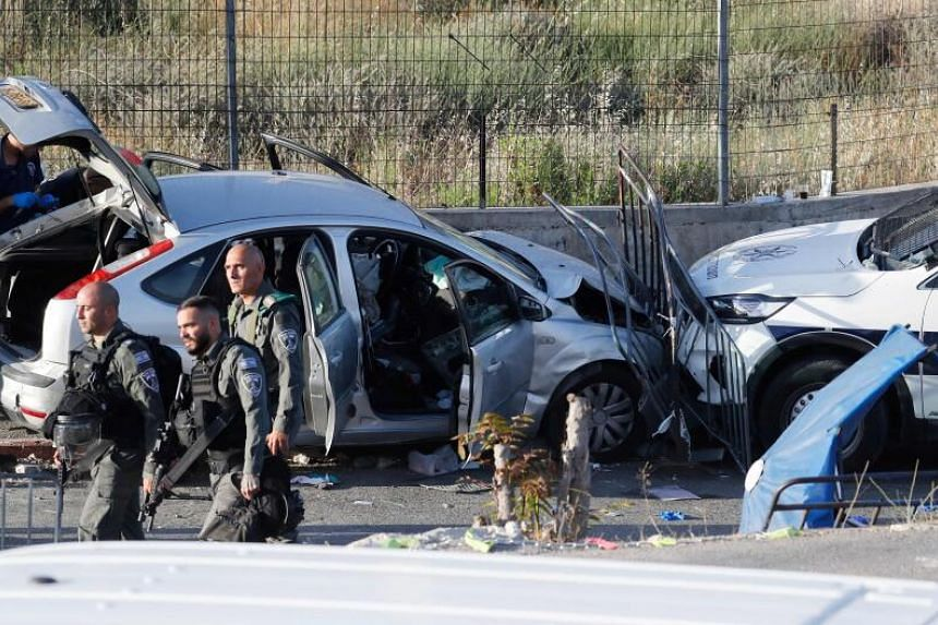 Israeli security forces inspect the scene of a car-ramming attack  on May 16, 2021.