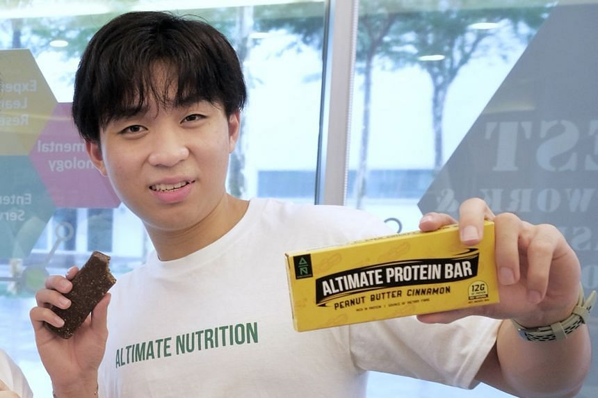 Altimate Nutrition co-founder Gavriel Tan with his company's protein bar made from cricket flour.