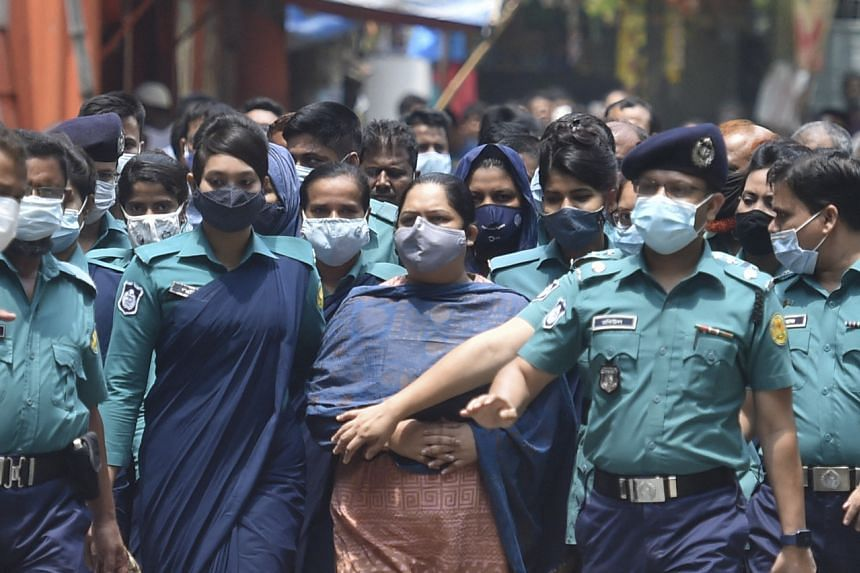 Police escort investigative journalist Rozina Islam to a court in Dhaka, on May 18, 2021.